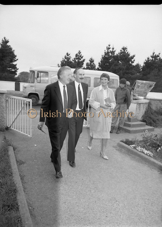 Charles Haughey Votes in Referendum..1983.07.09.1983.09.07.1983.7th September 1983..Image of Mr Charles Haughey, and his wife Maureen, arriving at Kinsealy National School in order to cast their votes in the referendum. ..The referendum was a constitutional amendment with regard to the life of the unborn... It was a divisive campaign with much debate, charge and countercharge by both sides of the argument..Those in the Yes campaign won the day with a vote of 841,233 to a no vote of 416,136..