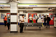 London Underground. Passengers waiting for the next train at Tower Hill station.
