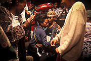 Travellers revel on the train between Dire Dawa and Addis Ababa. Ethiopia. The rail line originally built by the French in 1897 over 20 years, is the only route from Addis Ababa and the sea at Djibouti.