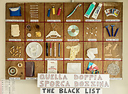 Italy, Capannori, Rossano Ercolini , founder of Centro di Ricerca Rifiuti Zero in his office. a kind of black list of non reciclyng packages