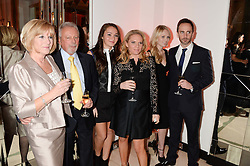 Left to right, JACKIE ADAMS, TONY ADAMS, LIBERTY ADAMS, LOUISE ADAMS, ? and CHRISTIAN ADAMS at the Harper???s Bazaar Women of the Year 2013 in association with Estťe Lauder, Audemars Piguet and Selfridges & Co. held at Claridge's, Brook Street, London on 5th November 2013.