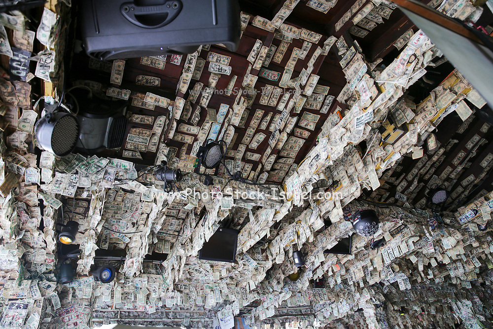 Willie T's Bar and Restaurant, on Duval Street, in Key West Florida, FL, USA. Decorated with dollar bills.
