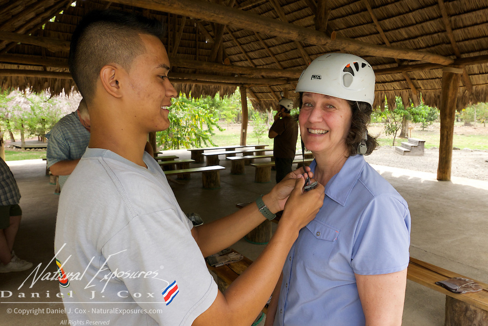Tish gets a helmet fitted for the zip line ride. Costa rRca.