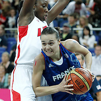 11 August 2012:  France Clemence Beikes looks to pass the ball during 86-50 Team USA victory over Team France, during the Women's Gold Medal Game, at the North Greenwich Arena, in London, Great Britain.