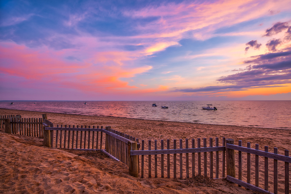 Scenic view across Cape Cod Bay and Thumpertown Beach at sunset. This beautiful Cape beach is located in Eastham, Massachusetts and only a few steps from one of Cape Cod's most iconic lighthouses Nauset Beach Light, famous for its logo appearance on the Cape Cod chips.<br /> <br /> Massachusetts Cape Cod Bay fine art photography images are available as museum quality photography prints, canvas prints, acrylic prints or metal prints. Fine art prints may be framed and matted to the individual liking and decorating needs:<br /> <br /> https://juergen-roth.pixels.com/featured/thumpertown-beach-at-cape-cod-bay-juergen-rothcape-cod-bay.html<br /> <br /> All New England photos are available for photography image licensing at www.RothGalleries.com. Please contact Juergen with any questions or request. <br /> <br /> Good light and happy photo making!<br /> <br /> My best,<br /> <br /> Juergen