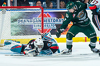 KELOWNA, BC - FEBRUARY 28: Ethan Regnier #7 of the Everett Silvertips watches for the puck as goalie Roman Basran #30 of the Kelowna Rockets makes a second period save at Prospera Place on February 28, 2020 in Kelowna, Canada. (Photo by Marissa Baecker/Shoot the Breeze)
