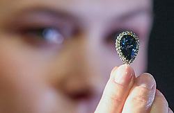 "© Licensed to London News Pictures. 06/04/2018. LONDON, UK. A model presents ""The Farnese Blue"", a 6.16-carat, pear-shaped, fancy, dark grey-blue diamond, with an estimate of US$3.7-5.3m, at a photocall at Sotheby's, New Bond Street.  The diamond was presented to Elisabeth Farnese, Queen of Spain in 1715 and has been passed down through four of Europe's royal families.  The diamond will be sold at auction in Geneva on 15 May.  Photo credit: Stephen Chung/LNP"