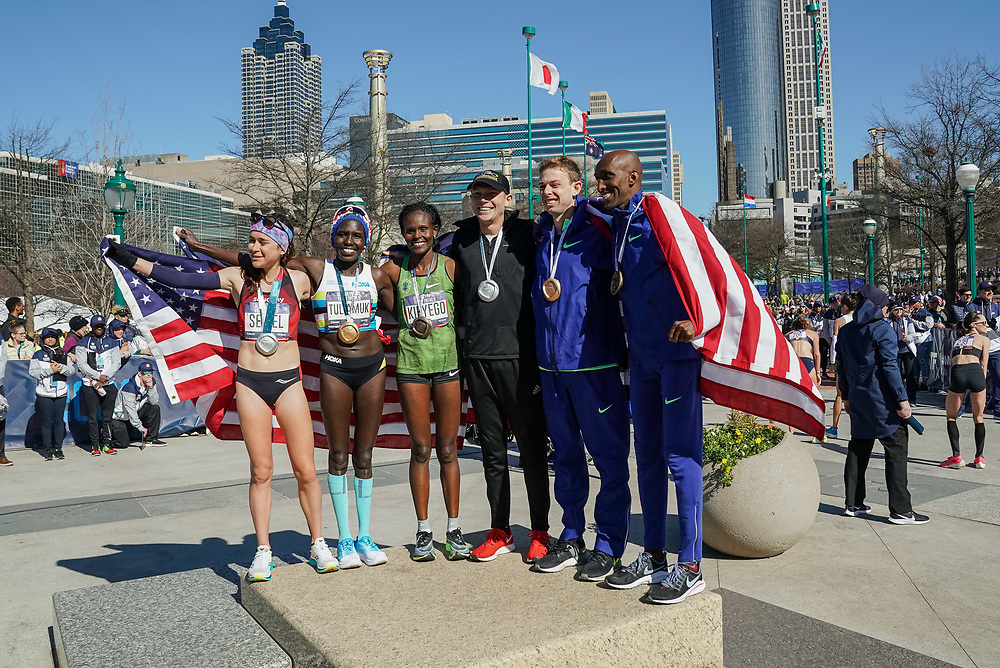 The men's and women's winners of the 2020 U.S. Olympic marathon trials in Atlanta on Saturday, Feb. 20, 2020. From left: Molly Seidel (second place, women's), Aliphine Tuliamuk (first place, women's), Sally Kipyego (third place, women's), Jacob Riley (second place, men's), Galen Rupp (first place, men's), and Abdi Abdirahman (third place, men's). Photo by Kevin D. Liles for The New York Times