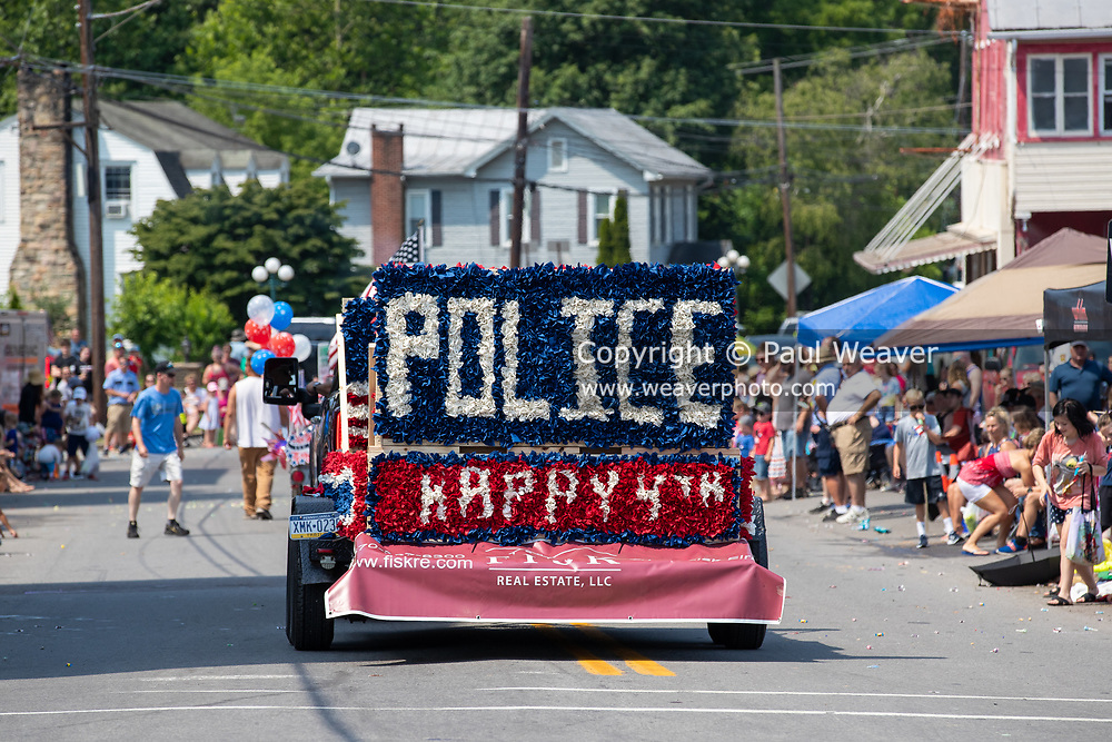 A local real estate firm's float honors police in the Independence Day parade in Millville, Pennsylvania on July 5, 2021.