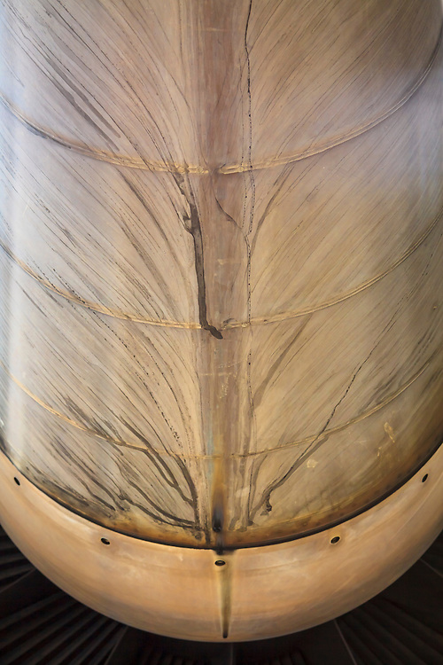 Abstract water patterns on the underside of a GE CF6-80C2A5 engine.