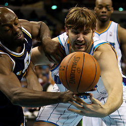 April 11, 2011; New Orleans, LA, USA; New Orleans Hornets center Aaron Gray (34) and Utah Jazz center Francisco Elson (16) battle for a loose ball during the second half at the New Orleans Arena. The Jazz defeated the Hornets 90-78.  Mandatory Credit: Derick E. Hingle