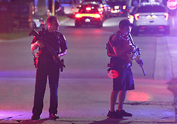 August 19, 2017 - Kissimmee, FL, USA - Law enforcement officers stand guard outside Osceola Regional Medical Center in Kissimmee, Fla., after two Kissimmee Police officers were shot on Friday, Aug. 18, 2017. (Credit Image: © Stephen M. Dowell/TNS via ZUMA Wire)