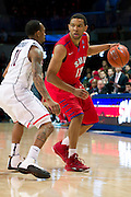 DALLAS, TX - JANUARY 4: Nick Russell #12 of the SMU Mustangs brings the ball up court against the Connecticut Huskies on January 4, 2014 at Moody Coliseum in Dallas, Texas.  (Photo by Cooper Neill) *** Local Caption *** Nick Russell