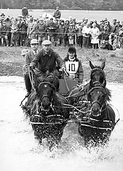 File photo dated 23/09/84 of the Duke of Edinburgh driving through a water obstacle during the Famous Grouse National Carriage Driving Championships at Windsor. Philip was an accomplished all-round sportsman with a particular passion for polo and carriage driving. Issue date: Friday April 9, 2021.