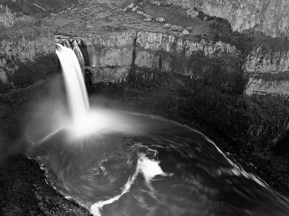Palouse Falls, in Eastern Washington, is one of the most dramatic waterfalls in the Pacific Northwest. Here the Palouse River plunges 180 feet into a basalt basin before making its final four mile run between steep canyon walls to its confluence with the Snake River.