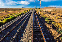 "Train tracks, Rovos Rail train  ""Pride of Africa"" crosses the Great Karoo Desert on it's journey between Pretoria and Cape Town, South Africa."