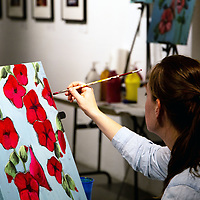 Jess Fort, 31, works on her painting August 23, 2018 at the Art123 Gallery in Downtown, Gallup, New Mexico during the Wine and Paint event put on by the GallupART organization.