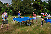 Playing table tennis on family weekend in Sussex garden