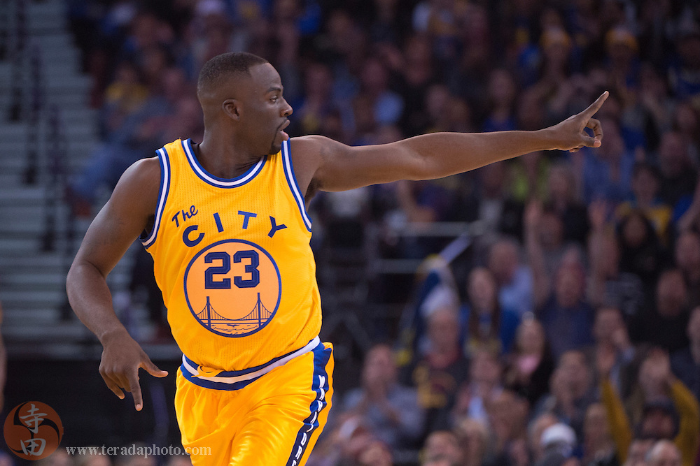 November 17, 2015; Oakland, CA, USA; Golden State Warriors forward Draymond Green (23) celebrates during the second quarter against the Toronto Raptors at Oracle Arena. The Warriors defeated the Raptors 115-110.
