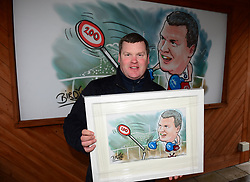 Trainer Gordon Elliott is presented with a Darren Bird cartoon to mark two hundred winning horses for the season, after winning the Boylesports Irish Grand National Chase, during BoyleSports Irish Grand National Day of the 2018 Easter Festival at Fairyhouse Racecourse, Ratoath, Co. Meath.