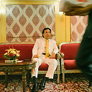 The manager wearing a white suit on the Palace on Wheels, a vintage luxury train crossing Rajahstan province.