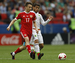 June 24, 2017 - Kazan, Russia - Aleksandr Golovin (L) of Russia national team and Jonathan Dos Santos of Mexico national team vie for the ball during the Group A - FIFA Confederations Cup Russia 2017 match between Russia and Mexico at Kazan Arena on June 24, 2017 in Kazan, Russia. (Credit Image: © Mike Kireev/NurPhoto via ZUMA Press)