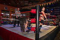 Deonna Purrazza and Karen Qu both into the ropes during Pro Wrestling Injustice for Brawl Saturday night at the Whiskey Barrel.  (Karen Bobotas/for the Laconia Daily Sun)
