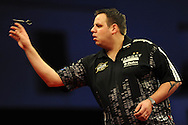 Adrian Lewis in action on his way to a  7-5 win against Robert Thornton..McCoy's Premier league darts, week 7 event at the Motorpoint Arena in Cardiff, South Wales on Thursday 21st March 2013. pic by Andrew Orchard, Andrew Orchard sports photography,