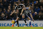 Brentford midfielder Josh McEachran and Brighton central midfielder, Andrew Crofts (8) during the Sky Bet Championship match between Brighton and Hove Albion and Brentford at the American Express Community Stadium, Brighton and Hove, England on 5 February 2016.
