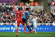 Nacer Chadli of Tottenham Hotspur  challenges Swansea city goalkeeper Lukasz Fabianski . Barclays premier league match, Swansea city v Tottenham Hotspur at the Liberty Stadium in Swansea, South Wales on Sunday 4th October 2015.<br /> pic by  Andrew Orchard, Andrew Orchard sports photography.