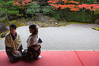 Japanese girls in Kimono at Entoku-in Garden, originally part of Fushimijo Castle and also a sub-temple of Kodaiji Temple. The northern dry garden shows the essence of Momoyama style and is a registered National Place of Scenic Beauty by the Japanese government. It was built in 1605 and dedicated as a Rinzai sect temple in 1633.