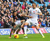 Blackpool's Jacob Murphy vies for possession with Leeds United's Alex Mowatt (left) and Tommaso Bianchi<br /> <br /> Photographer Kevin Barnes/CameraSport<br /> <br /> Football - The Football League Sky Bet Championship - Leeds United v Blackpool - Saturday 8th November 2014 - Elland Road - Leeds<br /> <br /> © CameraSport - 43 Linden Ave. Countesthorpe. Leicester. England. LE8 5PG - Tel: +44 (0) 116 277 4147 - admin@camerasport.com - www.camerasport.com