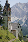 The church of Santa Berbura, founded and built by iron miners in 1490, in the Dolomites near La Val in Alta Badia, south Tyrol, Italy.
