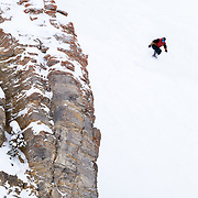 Travis Rice in mid-couloir air.