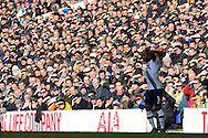 the fans shade the winter sun from  their during the 1st half. Barclays Premier league match, Tottenham Hotspur v Swansea city at White Hart Lane in London on Sunday 28th February 2016.<br /> pic by John Patrick Fletcher, Andrew Orchard sports photography.