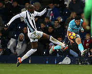 Allan Nyom of West Bromwich Albion (l) blocks a cross from Jefferson Montero of Swansea city. Premier league match, West Bromwich Albion v Swansea city at the Hawthorns stadium in West Bromwich, Midlands on Wednesday 14th December 2016. pic by Andrew Orchard, Andrew Orchard sports photography.