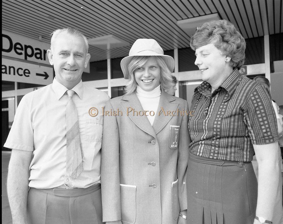 Olympic Team Leaves Dublin Airport.05/07/1976<br /> Deirdre Sheehan swimming with her parents Dr. and Mrs. John Sheehan. Wilton Cork.