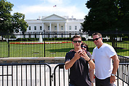 WASHINGTON - JUNE 29, 2019: Visitors take photos of themselves in front of The White House on Pennsylvania Avenue NW on June 29, 2019, in Washington, D.C.