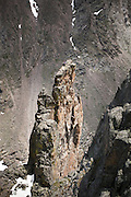 Climbers sit on the summit of Petit Grepon, a rock spire in Rocky Mountain National Park, Colorado.