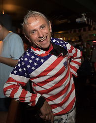 © Licensed to London News Pictures. 13/07/2018. London, UK.  Ray, a Trump supporter at the Donald Trump special relationship evening and welcome party held at  the Trump Arms Pub (formerly known as Jameson Pub) in Hammersmith, west London. The pub has been decked out with American flags and banners celebrating Donald Trump's arrival in the UK..  Photo credit: Vickie Flores/LNP