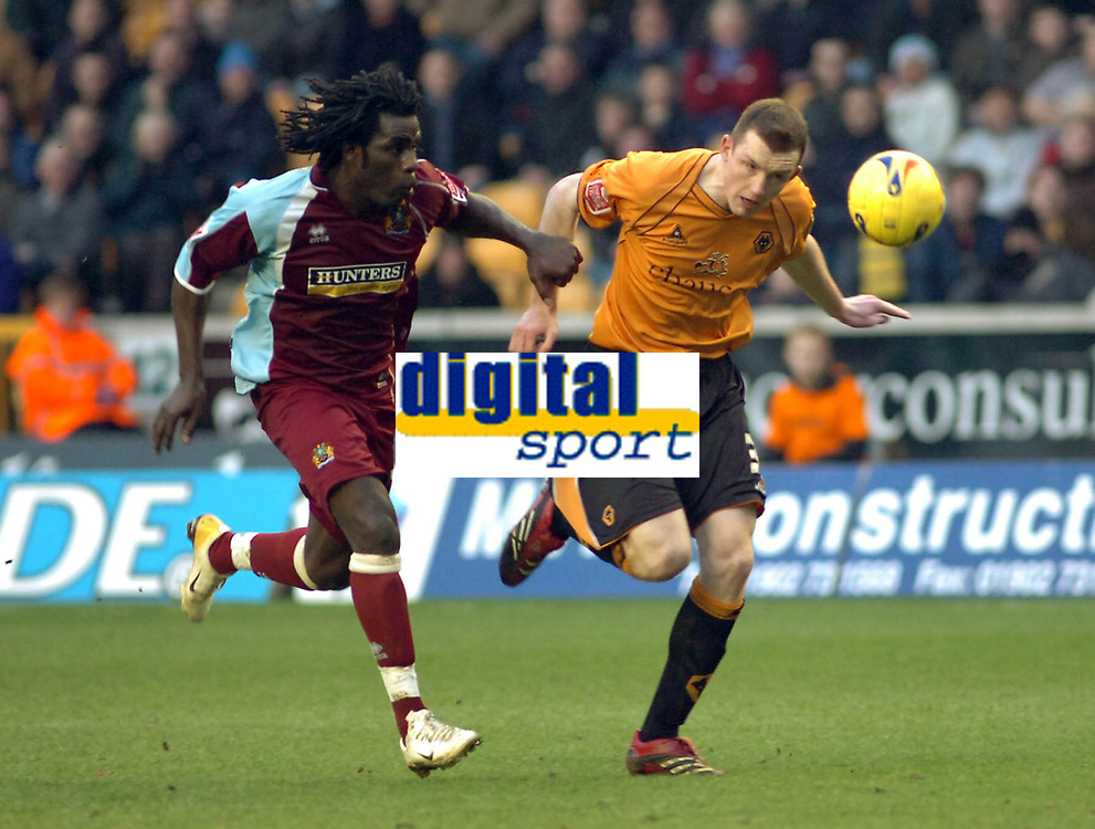 Photo: Kevin Poolman.<br />Wolverhampton Wanderers v Burnley. Coca Cola Championship. 17/02/2007. Ade Akinbiyi of Burnley can't get the better of Neill Collins of Wolves.