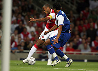 Photo: Chris Ratcliffe.<br /> Arsenal v FC Porto. UEFA Champions League, Group G. 26/09/2006.<br /> Thierry Henry of Arsenal clashes with Bruno Alves of Porto.