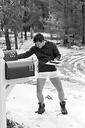 man getting the mail in his underwear on a winter day