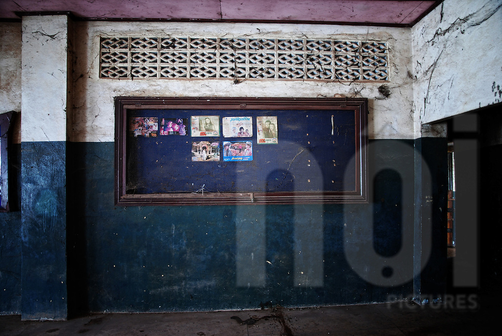 Blackboard covered with a grid in the abandoned cinema of Bouasavanh, Vientiane, Laos, Asia. Pictures of movie stars are stick on it