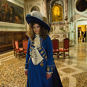 "VENICE, ITALY - FEBRUARY 16:  A c member of staff poses for pictures ahead of one of the most exclusive carnival ball ""1796-2012 the End of Carnival"" organised by Atelier Pietro Longhi at Scuola Grande S Giovanni Evangelista on February 16, 2012 in Venice, Italy.  The annual festival, which lasts nearly three weeks, will see the streets and canals of Venice filled with people wearing highly-decorative and imaginative carnival costumes and masks.  (Photo by Marco Secchi/Getty Images)> on February 16, 2012 in Venice, Italy.  (Photo by Marco Secchi/Getty Images)"
