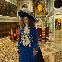 """VENICE, ITALY - FEBRUARY 16:  A c member of staff poses for pictures ahead of one of the most exclusive carnival ball """"1796-2012 the End of Carnival"""" organised by Atelier Pietro Longhi at Scuola Grande S Giovanni Evangelista on February 16, 2012 in Venice, Italy.  The annual festival, which lasts nearly three weeks, will see the streets and canals of Venice filled with people wearing highly-decorative and imaginative carnival costumes and masks.  (Photo by Marco Secchi/Getty Images)> on February 16, 2012 in Venice, Italy.  (Photo by Marco Secchi/Getty Images)"""