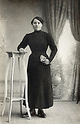 classical vintage studio portrait of a full length standing female person