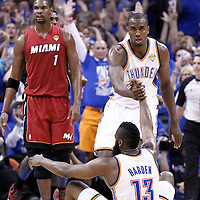 12 June 2012: Oklahoma City Thunder power forward Serge Ibaka (9) helps Oklahoma City Thunder guard James Harden (13) to stand up during the Oklahoma City Thunder 105-94 victory over the Miami Heat, in Game 1 of the 2012 NBA Finals, at the Chesapeake Energy Arena, Oklahoma City, Oklahoma, USA.