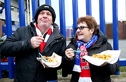 A general view of fans outside Goodison Park eating fish and chips prior to the beginning of the match