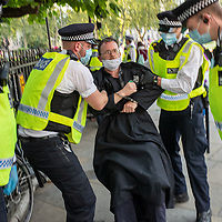 Fr. Martin Newell is handcuffed and arrested during civil disobedience protests in Parliament Square London urging the government to take action on climate change. Fr Newell is part of an ecumenical group called Christian Climate Action, several of whom were arrested along with hundreds of other people from Extinction Rebellion.